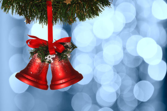 Christmas bells against defocused background with shallow depth of field and copyspace